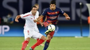 Barcelona's Uruguayan forward Luis Suarez (R) vies with Sevilla's Adil Rami during the UEFA Super Cup final football match between FC Barcelona and Sevilla FC in Tbilisi on August 11, 2015. AFP PHOTO / KIRILL KUDRYAVTSEV (Photo credit should read KIRILL KUDRYAVTSEV/AFP/Getty Images)